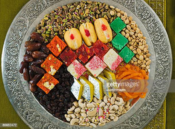 platter of diwali sweets - diwali sweets stock photos and pictures