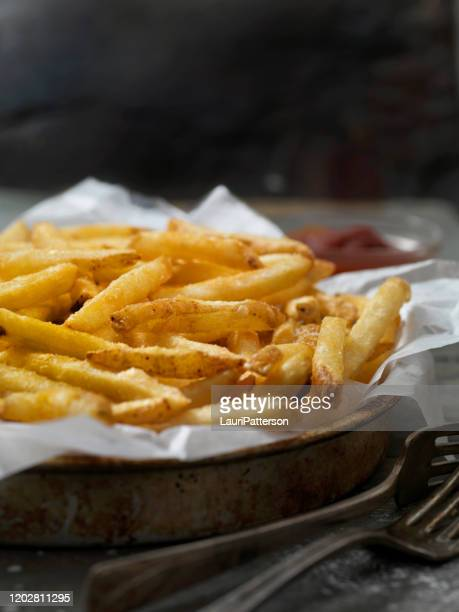 platter of hand cut cut fries - french fries stock pictures, royalty-free photos & images