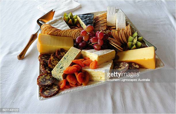 A platter of local King Island produce. Soft and hard cheeses produced in the Cheese factory at Porkies Creek. Bass Strait, Tasmania.