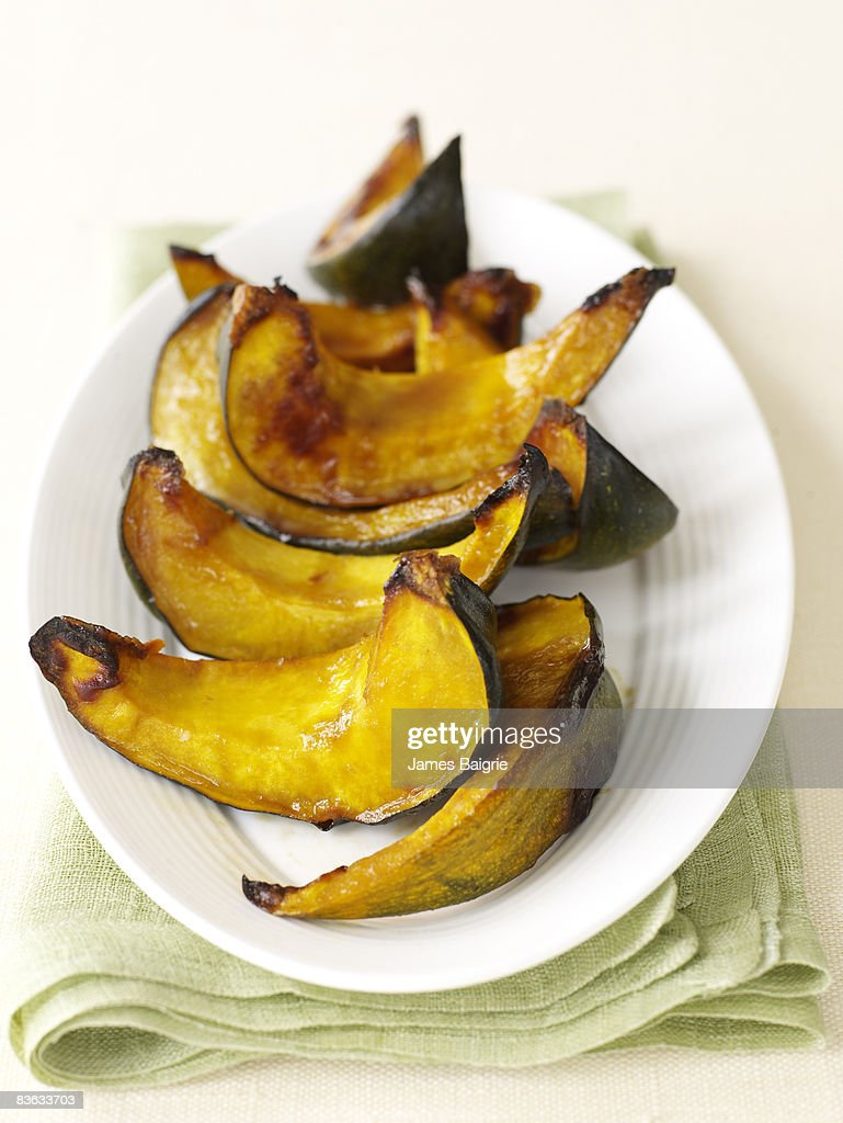 Platter of roasted acorn squash : Stock Photo