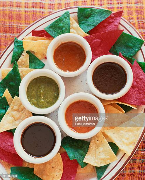 platter with assortment of mole sauces and chips - mole sauce stock pictures, royalty-free photos & images