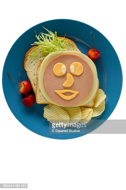 platter with face made from bologna sandwich - baloney stock photos and pictures