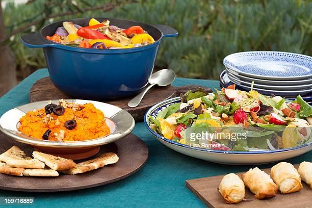 platters of mashed carrot dip, egg rolls & salad - 盛り皿 ストックフォトと画像