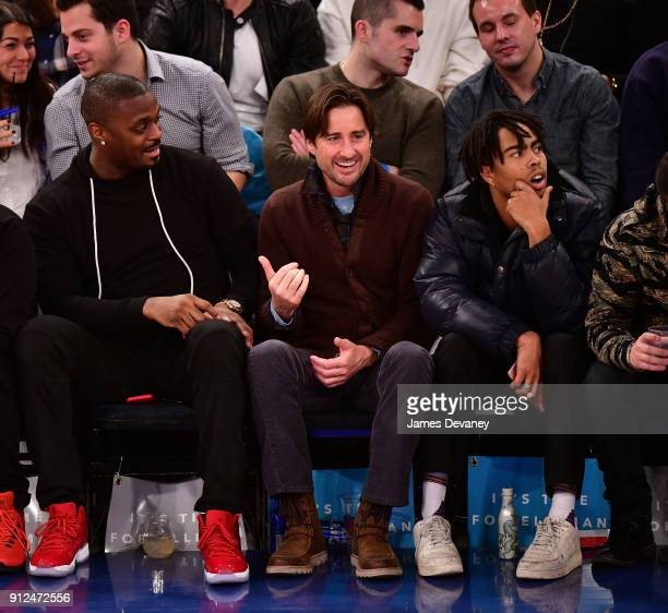 Plaxico Burress Luke Wilson and guest attend the New York Knicks vs Brooklyn Nets game at Madison Square Garden on January 30 2018 in New York City