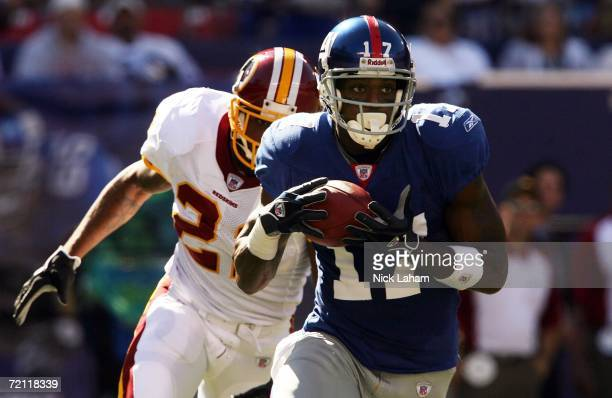 Plaxico Burress of the New York Giants runs for a 46yard gain in front of Sean Taylor of the Washington Redskins on October 8 2006 at Giants Stadium...
