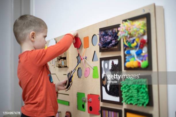 play as a way of solving problems - montessori education stock pictures, royalty-free photos & images