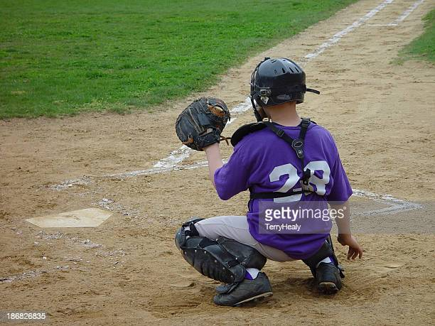 play at home plate - purple glove stock pictures, royalty-free photos & images