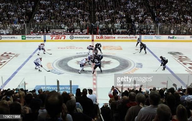 Play begins after the first faceoff in a game between the Winnipeg Jets and the Montreal Canadiens in NHL action at the MTS Centre on October 9 2011...