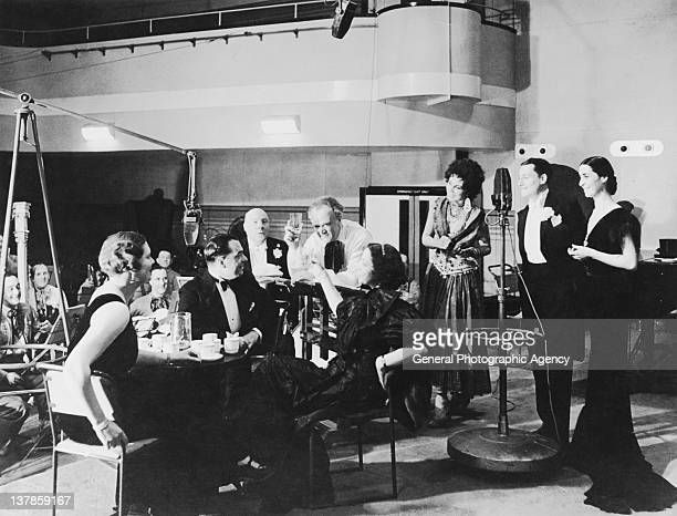 A play being performed in costume at a BBC radio studio circa 1935