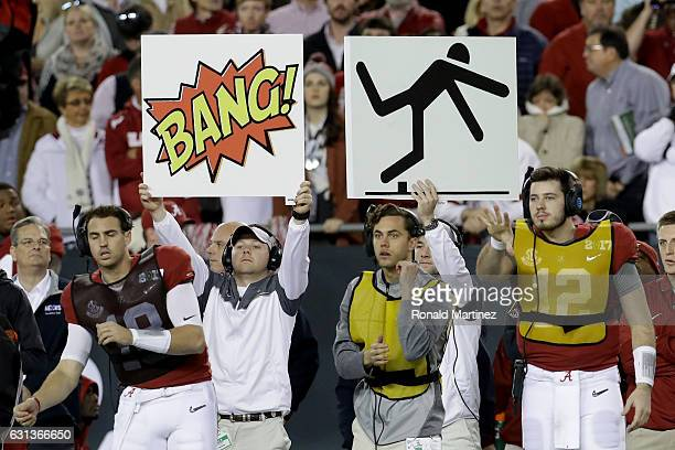 Play call signs are seen on the Alabama Crimson Tide sideline during the first half of the 2017 College Football Playoff National Championship Game...