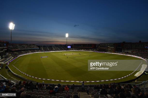 Play continues at dusk during the first OneDay International cricket match between England and the West Indies at Old Trafford Manchester on...
