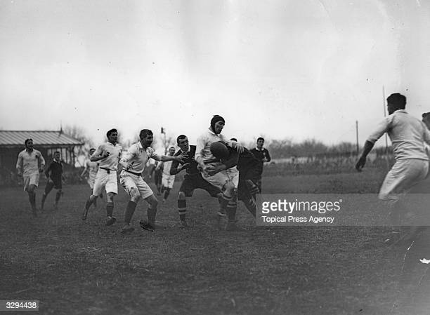 Play during an international rugby match between England and Wales at Swansea which ended in a 220 victory for Wales George Travers the Welsh forward...