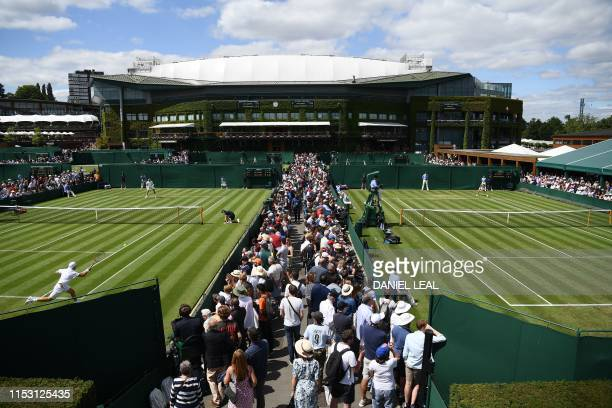 Play goes on on the outer courts at The All England Tennis Club in Wimbledon, southwest London, on July 1 on the first day of the 2019 Wimbledon...