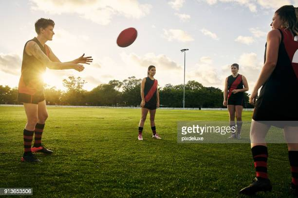 play hard, smart and together - afl stock pictures, royalty-free photos & images