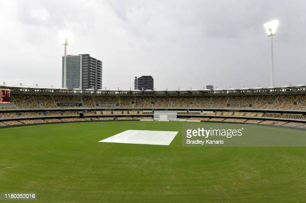 Play is delayed due to poor weather during day two of the Sheffield Shield match between Queensland and New South Wales at The Gabba on October 11...