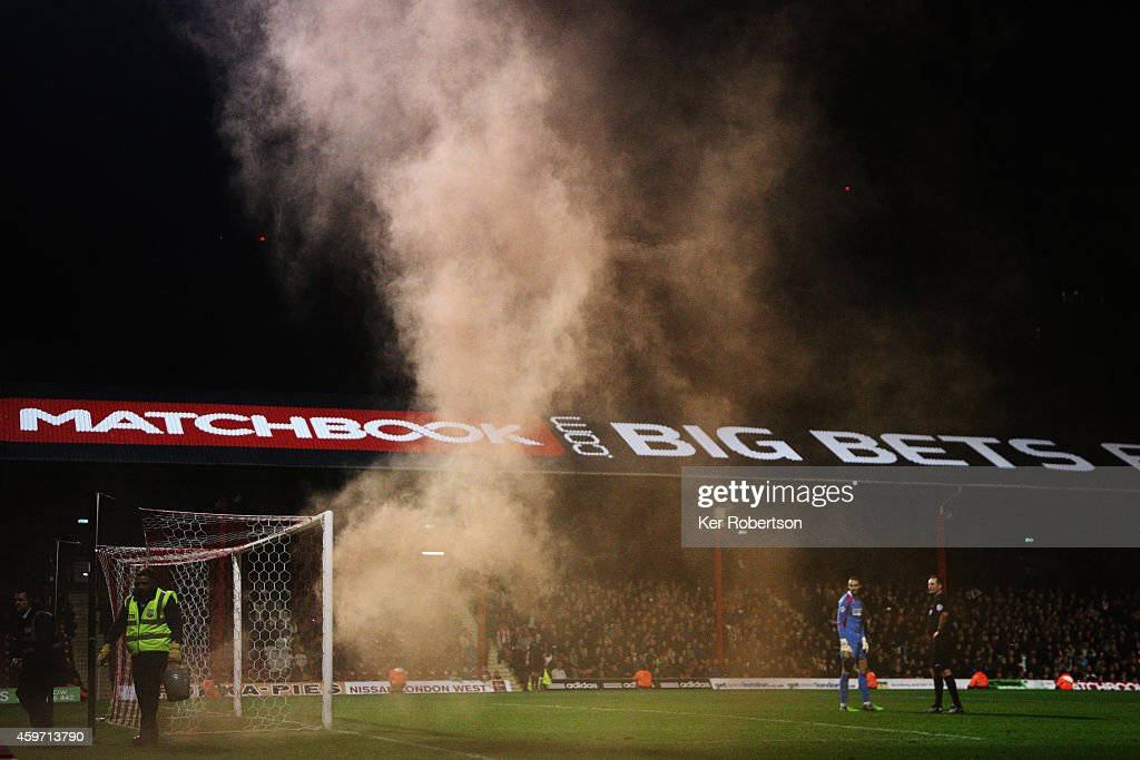 Play is halted after a distress flare is thrown onto the pitch during the Sky Bet Championship match between Brentford and Wolverhampton Wanderers at Griffin Park on November 29, 2014 in Brentford, England.