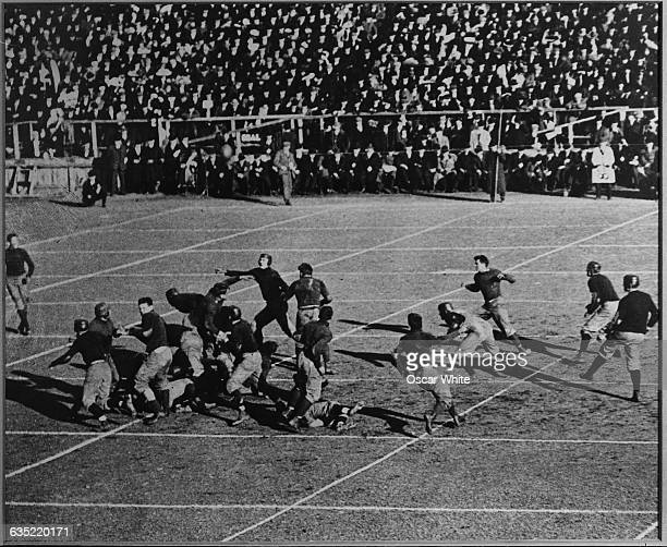 Play is made during the first football game ever played between teams from Harvard and Yale. The game was played at Hamilton Park on Saturday,...