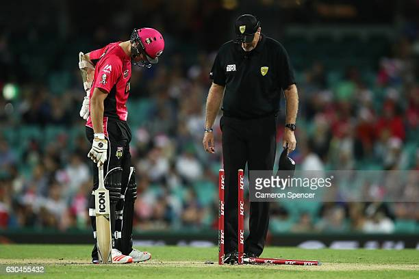 Play is paused after the middle stump was broken during the Big Bash League match between the Sydney Sixers and Hobart Hurricanes at Sydney Cricket...