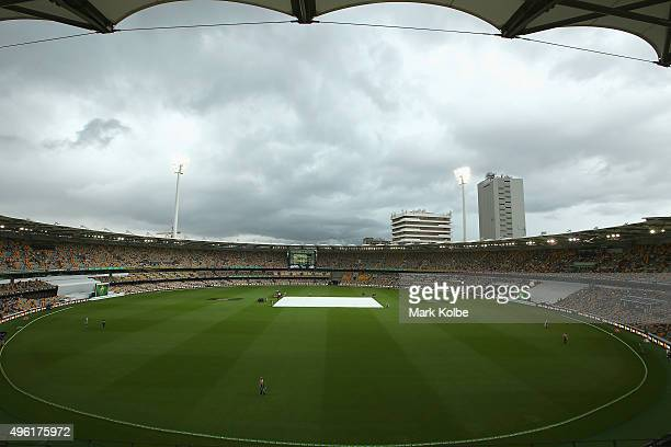 Play is suspended as a storm looms during day four of the First Test match between Australia and New Zealand at The Gabba on November 8 2015 in...