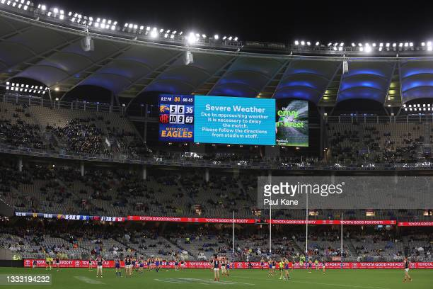 Play is suspended due to lightning in the area during the round 21 AFL match between West Coast Eagles and Melbourne Demons at Optus Stadium on...