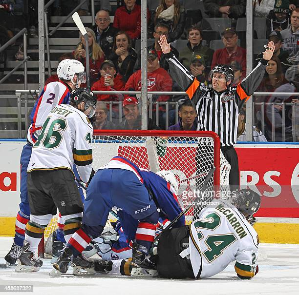 Play is whistled dead by referee Mike Cairns between the Windsor Spitfires and the London Knights in an OHL game at Budweiser Gardens on November 7...
