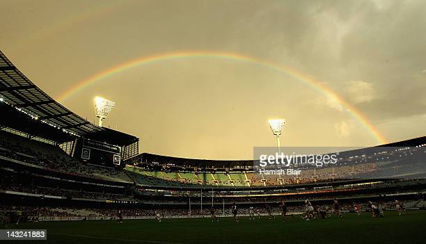 Play takes place under a rainbow during the round four AFL match between the Melbourne Demons and the Western Bulldogs at Melbourne Cricket Ground on...