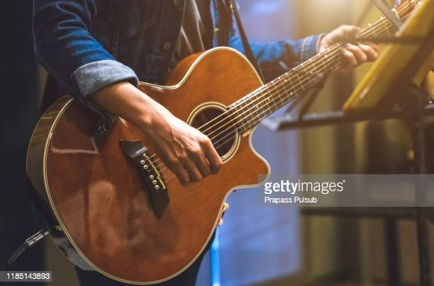 play the guitar by hand artist musician - blues music stock pictures, royalty-free photos & images