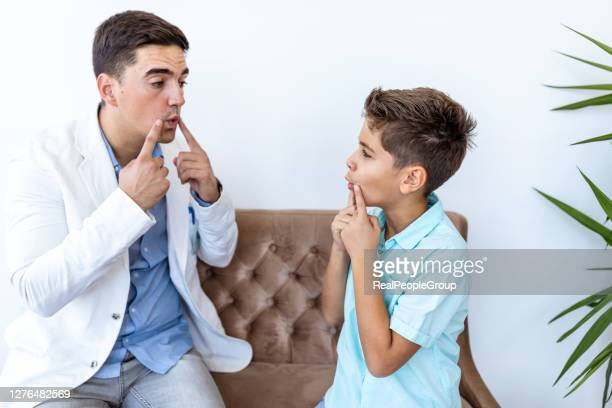 play therapist and a young patient working together - autism stock pictures, royalty-free photos & images