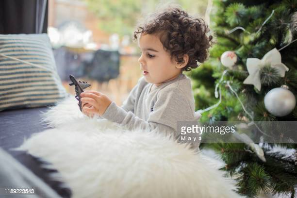 play time - christmas plane stock pictures, royalty-free photos & images