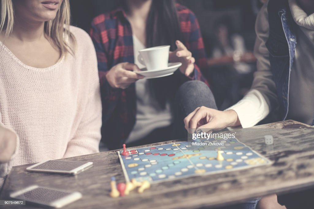 Play together a social game. Focus on hand. : Stock Photo