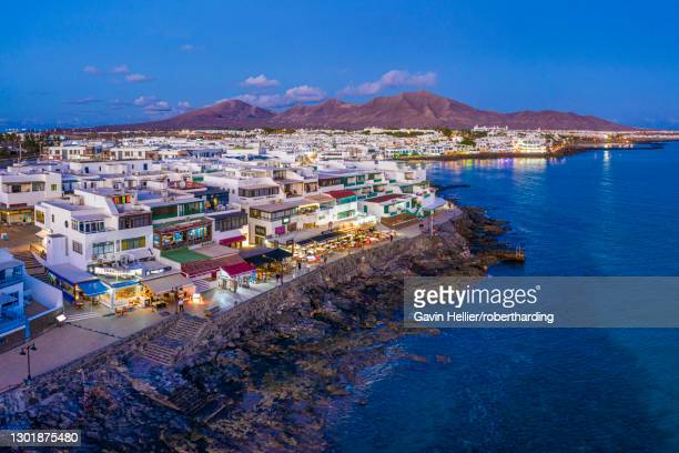 playa blanca at dusk, lanzarote, canary islands, spain, atlantic, europe - gavin hellier stock pictures, royalty-free photos & images