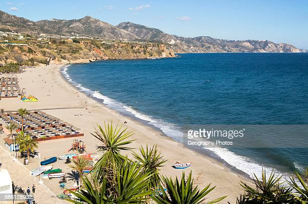 Playa Burriana sandy beach at popular holiday resort town of Nerja Malaga province Spain