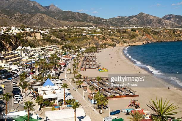 Playa Burriana sandy beach at popular holiday resort town of Nerja Malaga province Spain