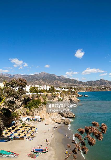 Playa Calahonda sandy beach at popular holiday resort town of Nerja, Malaga province, Spain.
