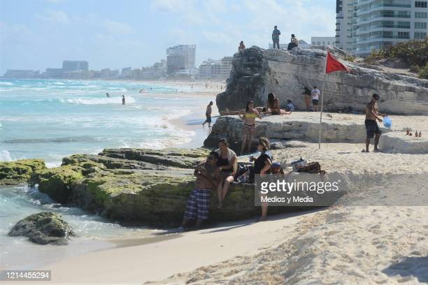 Playa Gaviota Azul' also known as 'Playa Forum' recorded almost normal tourist activity, on March 23, 2020 in Cancún, Mexico. As COVID-19 spreads...