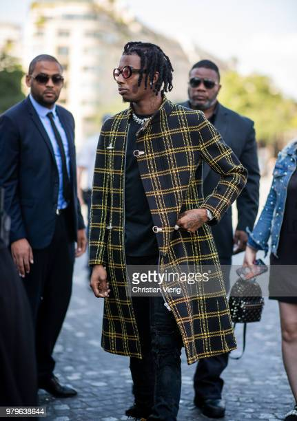 Playboi Carti wearing plaid coat is seen outside Off/White on day two of Paris Fashion Week Menswear SS19 on June 20, 2018 in Paris, France.
