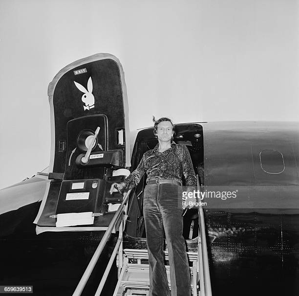 Playboy boss Hugh Hefner arrives at London Airport UK 4th August 1971