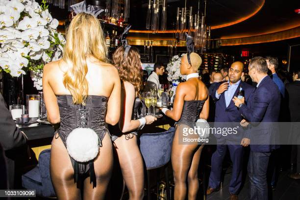 Playboy Bunnies carry trays of champagne during the grand opening of the Playboy Club in New York US on Wednesday Sept 12 2018 The opening ofthe...