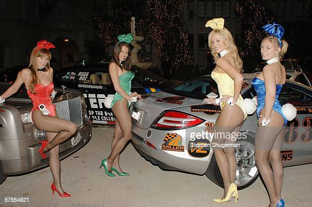 Playboy bunnies pose with cars from the rally at the Gumball 3000 Playboy Mansion Party at the Playboy Mansion on May 7 2006 in Los Angeles California