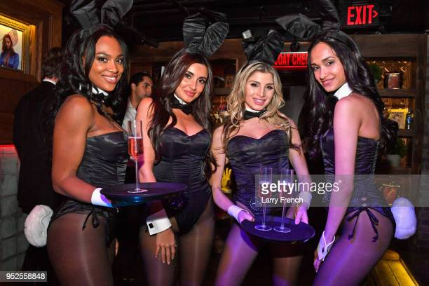 Playboy Bunnies serve glasses of Pink Party Rose during the Playboy Presents No Tie Party at The Living Room on April 28 2018 in Washington DC