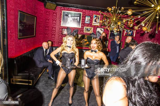 Playboy Bunnies stand for a photograph during the grand opening of the Playboy Club in New York US on Wednesday Sept 12 2018 The opening ofthe...