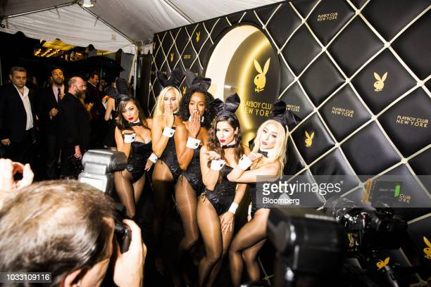 Playboy Bunnies stand for photographs on the red carpet during the grand opening of the Playboy Club in New York US on Wednesday Sept 12 2018 The...