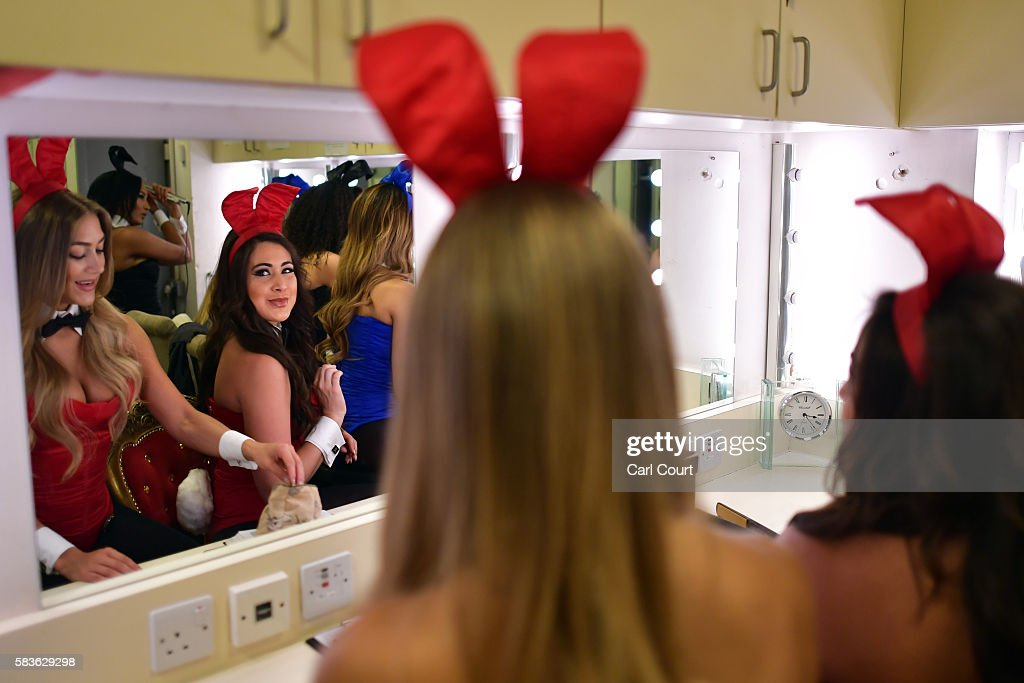 Playboy Bunny, Gabi (surname not given), looks in a mirror as she prepares herself before starting work at the Playboy Club on July 26, 2016 in London, England. The Playboy Club London is celebrating its 50th anniversary this year and will mark the event with a 'Touch of Gold' party on July 29.