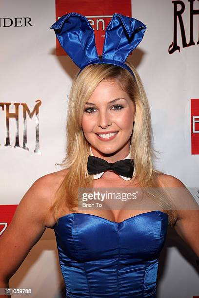 Playboy bunny model Michelle McLaughlin poses at Stars Stripes An Evening of Sexy Patriotism Wounded Warrior Project at The Playboy Mansion on May 16...