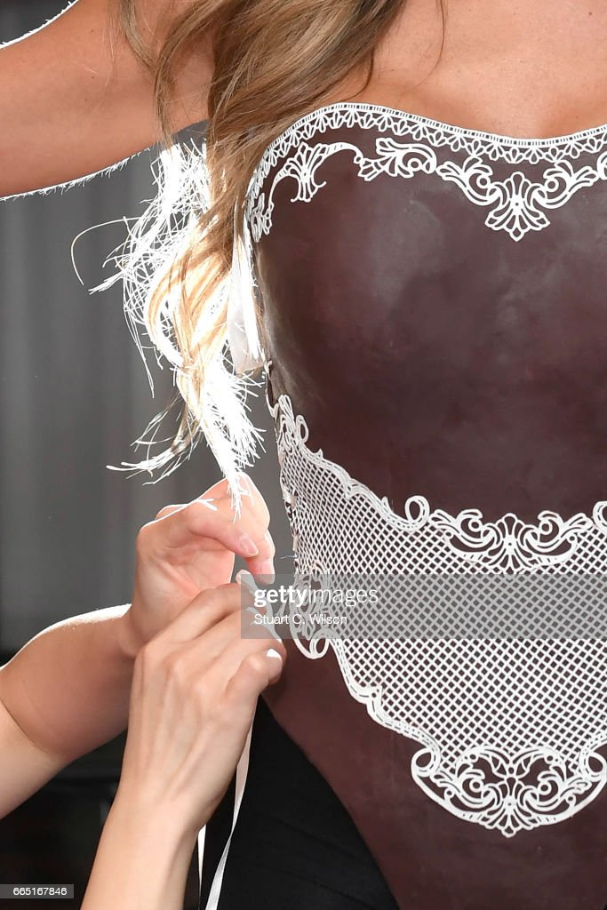 Playboy Bunny Penny Delbaugh is fitted with an edible chocolate corset and bunny ears, the world's first Chocolate Easter Playboy Bunny, on April 6, 2017 in London, England.