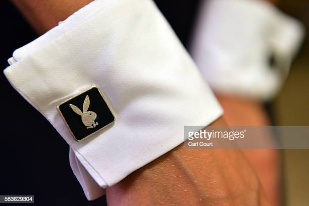 Playboy Bunny shows her cufflinks as she prepares herself before starting work at the Playboy Club on July 26 2016 in London England The Playboy Club...