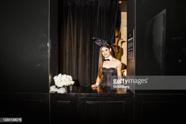 A Playboy Bunny stands for a photograph in the coat check area during the grand opening of the Playboy Club in New York US on Wednesday Sept 12 2018...