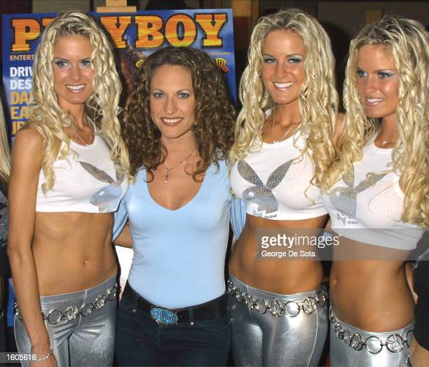 Playboy celebrity model Jerri Manthey center from the telvesion show Survivor The Australian Outback poses with fellow Playmates the Dahm Triplets...