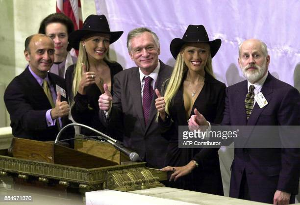 Playboy Chairman Emeritus and Founder Hugh Hefner is surrounded by his girlfriends Sandy and Mandy Bentley and New York Stock Exchange Chairman...