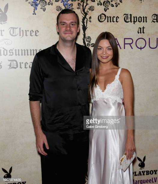 Playboy Chief Creative Officer Cooper Hefner and actress Scarlett Byrne arrive at Playboy's Midsummer Night's Dream at the Marquee Nightclub at The...